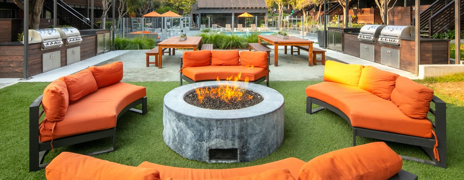 Large outdoor BBQ area with a fire pit and plenty of seating