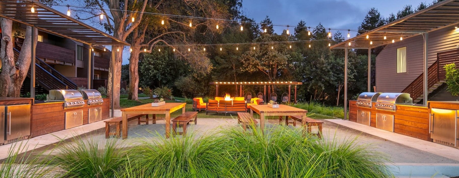 outdoor lounge area with a fire pit and near the pool